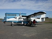A Twin Otter loading passengers at the Tuktoyaktuk, NWT airport